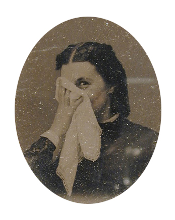 woman covering her face with a handkerchief